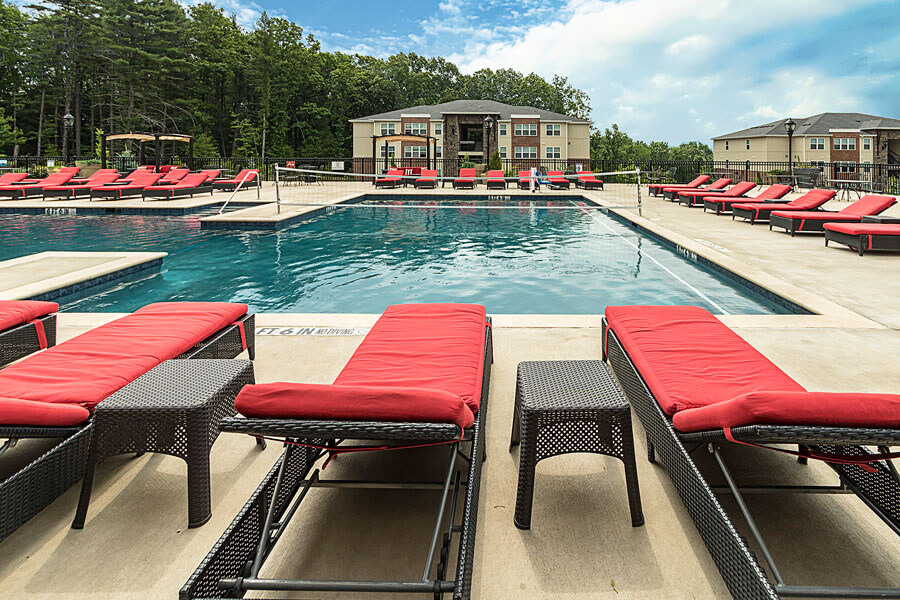 A poolside promo photo of a Penn State student apartment complex by State College real estate photographer Rusty Glessner