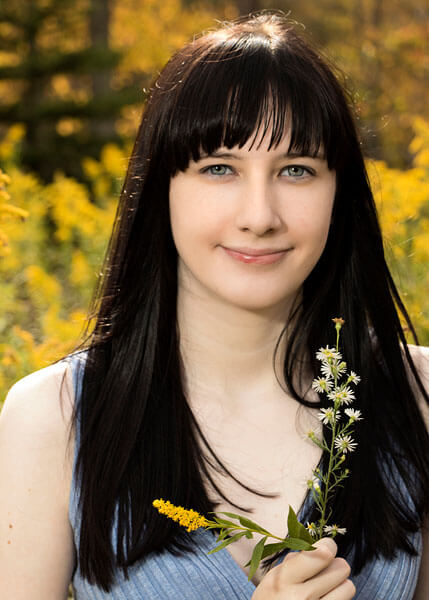 A senior portrait in a field of goldenrod by State College portrait Photographer Rusty Glessner