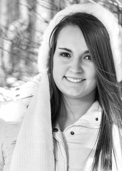A wintertime senior portrait by State College portrait photographer Rusty Glessner
