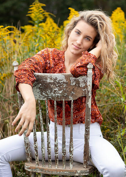 Using a weathered wooded chair as a prop in this shot by State College portrait photographer Rusty Glessner