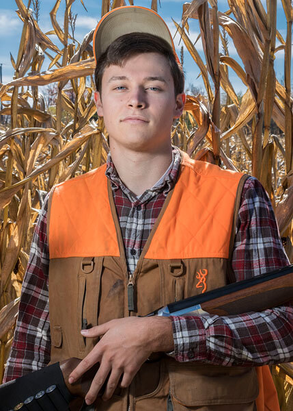 A hunting-themed senior portrait by State College portrait photographer Rusty Glessner