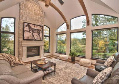 residential stacked stone fireplace and hardwoods