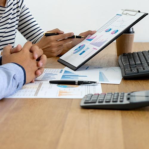 hands holding analytics document