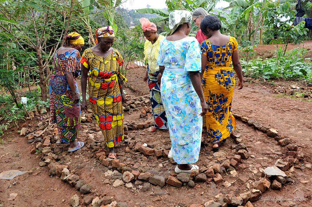 Women walk 3-circuit labyrinth in Buvaku by Jill K H Geoffrion, photographer