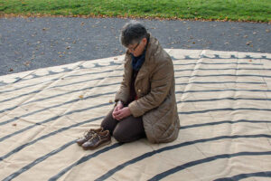 Kneeling on a labyrinth by Jill K H Geoffrion, photographer