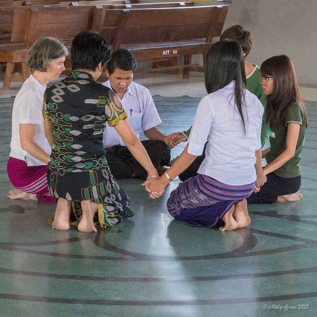 Praying together in the center of the labyrinth by Jill K H Geoffrion, Photographer