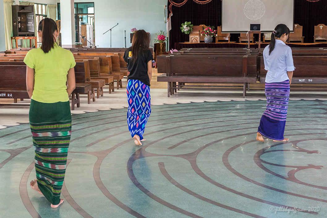 Women walk labyrinth in Myanmar by Jill K H Geoffrion, photographer