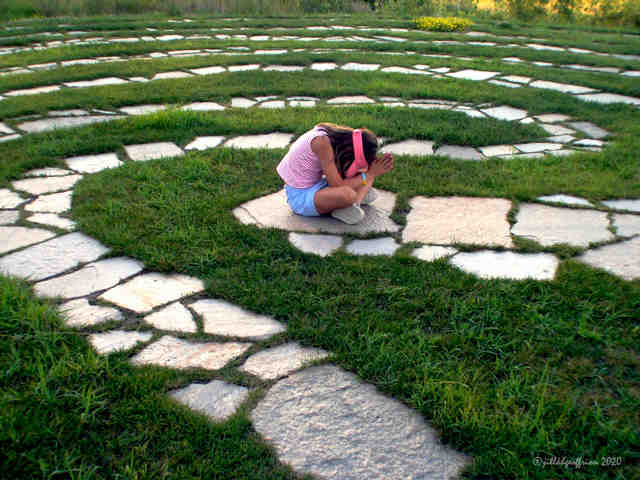 Praying in the center of the labyrinth by Jill K H Geoffrion, photographer