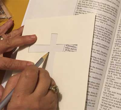 Photo showing sketching the outline of the cross.