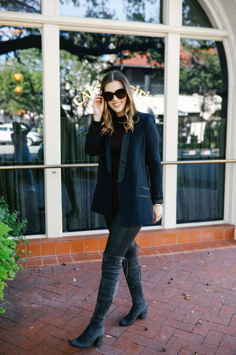 faux leather leggings outfit, how to style faux leather leggings, spanx faux leather leggings outfit, black spanx faux leather leggings, winter outfit idea, turtleneck outfit idea, black blazer outfit, stuart weitzman tieland boot, celine sunglasses   Top Dallas fashion blog, Never Without Lipstick features a chic way to style SPANX faux leather leggings: image of a woman wearing SPANX faux leather leggings, FREE PEOPLE black turtleneck, a boyfriend blazer Stuart Weitzman over the knee boots.