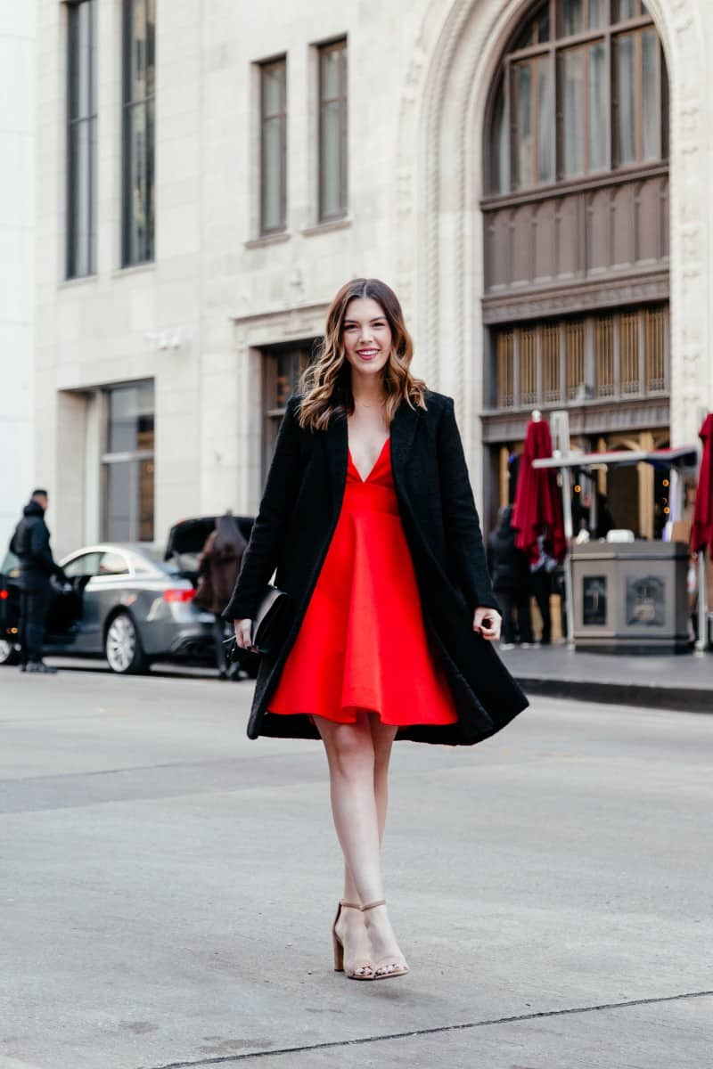 valentines day outfits, valentines looks, red dress outfit, date night outfit, womens style, womens outfit ideas, gucci clutch bag | 5 Effortless Valentine's Day Outfits styled by top US fashion blog, Never Without Lipstick: image of a woman wearing a red Mac Duggal dress, Sam Edelman sandals and a Mango coat