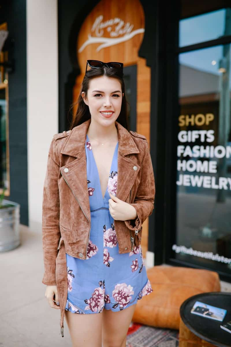   5 Winter Essentials to Recycle for Spring featured by top US fashion blog, Never Without Lipstick: image of a woman wearing a BLANKNYC suede moto jacket