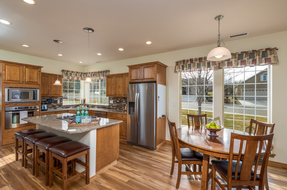 Kitchen with Dining Room and Windows 5