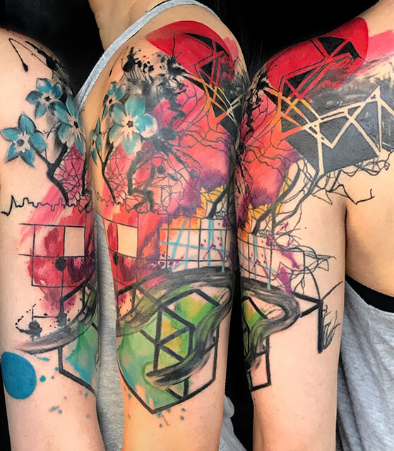Abstract watercolor half sleeve tattoo