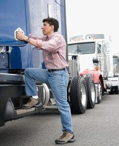 bigstock-Man-boarding-truck-12054188-e1474980761219