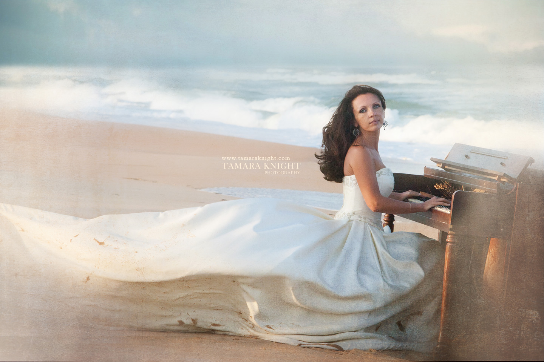 Beautiful model in a wedding dress by Tamara Knight Photography