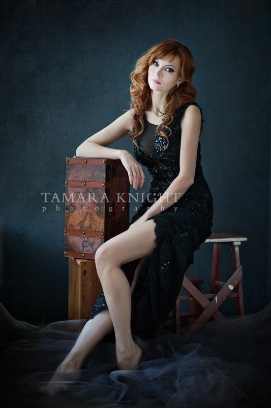 Beautiful redhead in a black dress