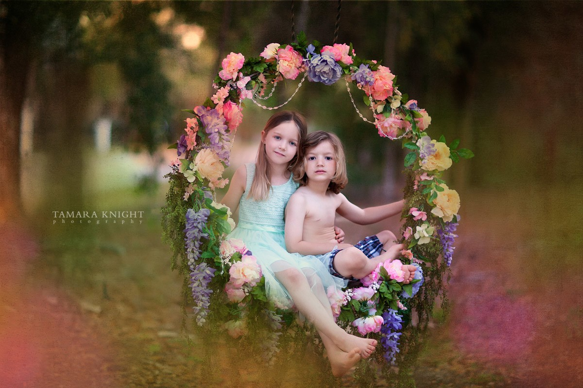 A sleeping fairy sitting on a flower swing. The shoot is done in Orlando area by Orlando photographer