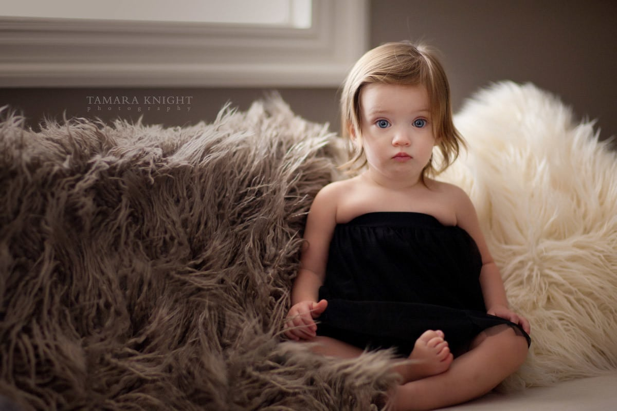 Baby girl sitting on a couch done by Orlando photographer, maternity Orlando