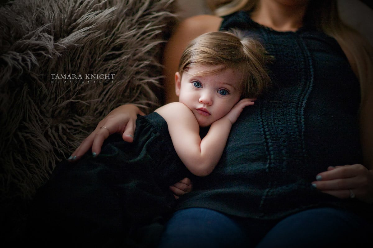 Baby girl hugging Mother's belly done by Orlando photographer, maternity Orlando