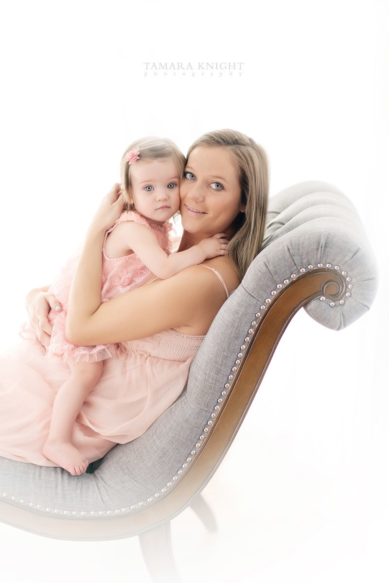 Maternity portrait of a beautiful Mother-to-with her baby girl be in a pink dress by Orlando photographer, maternity Orlando
