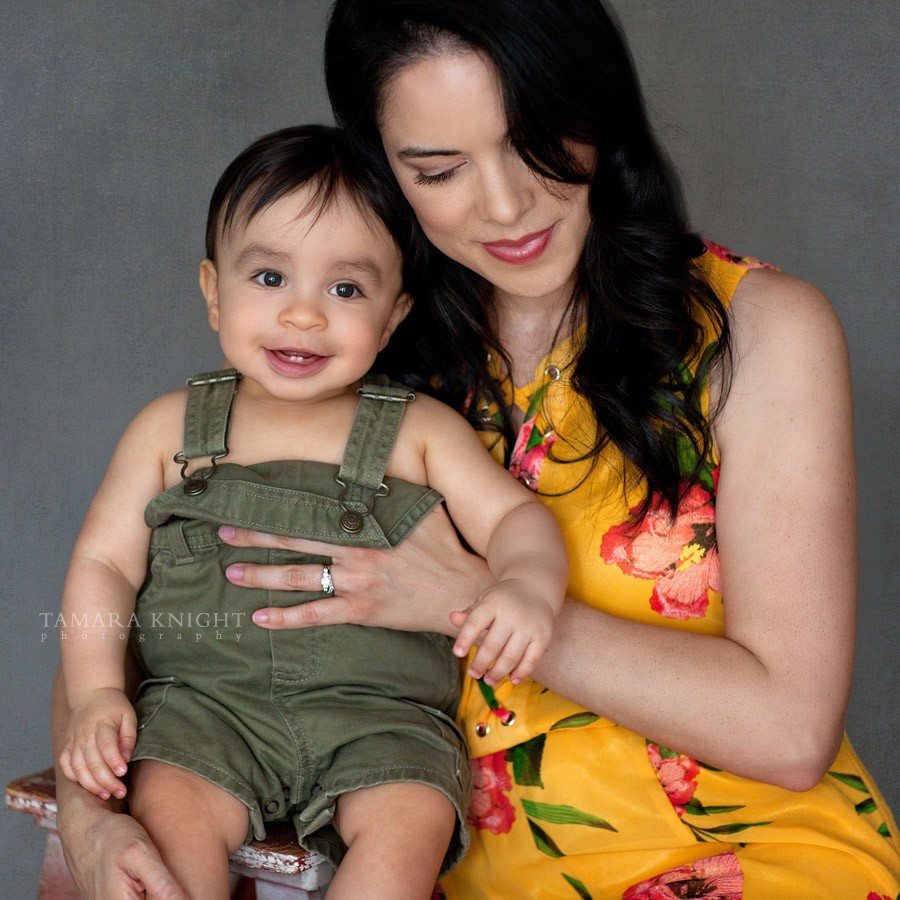 Mother is hugging her baby boy by your Orlando family photographer