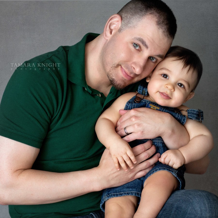 Father is hugging his baby boy by your Orlando family photographer