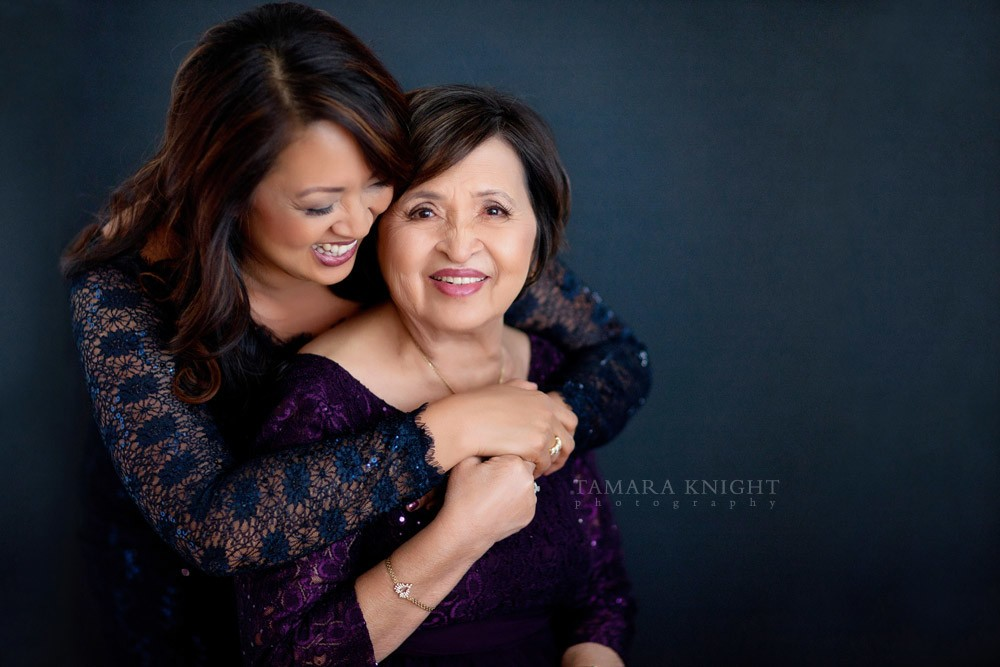 A portrait of laughing Mom and daughter by Orlando photographer