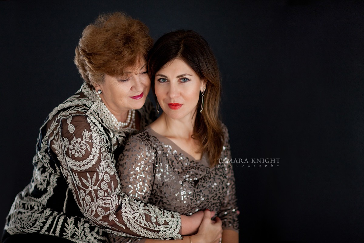 Mom is hugging her daughter, family portrait by Orlando photographer