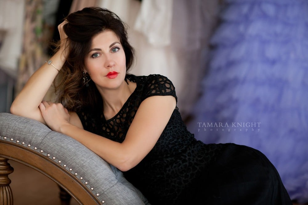 Stunning woman leaning on a chair, beauty by Orlando photographers