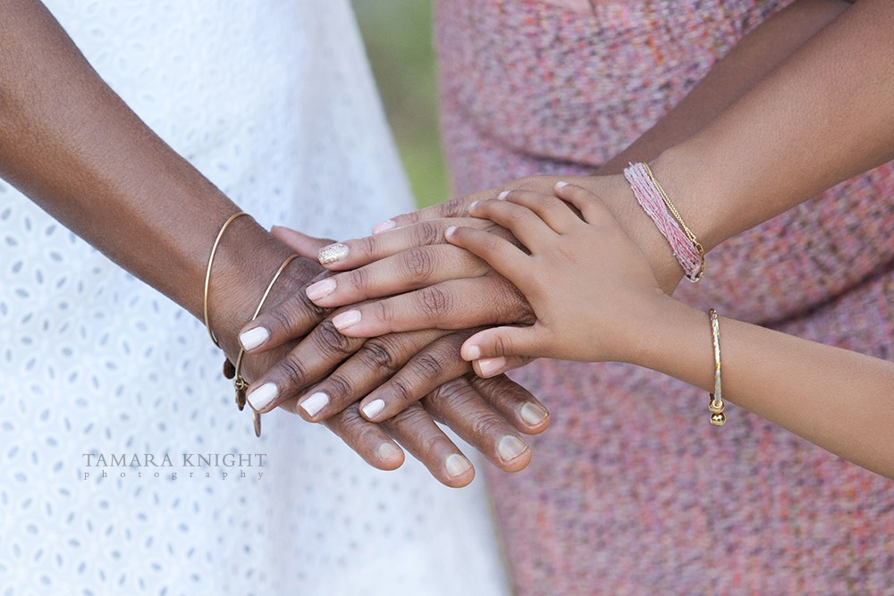 Generations portrait featuring 4 different hands on top of each other by Tamara Knight Orlando Photographer