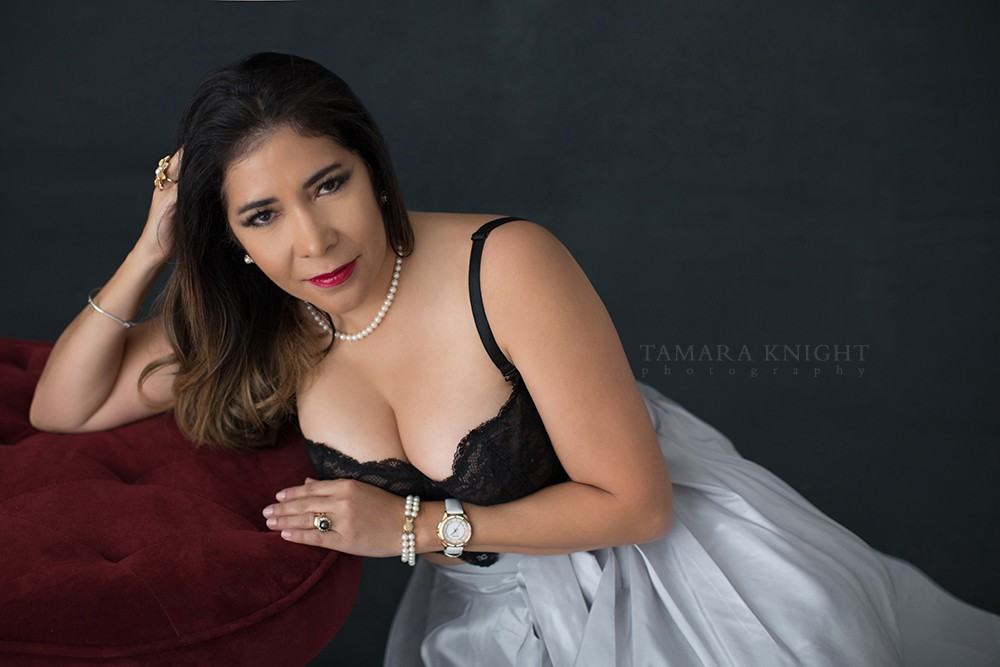 woman in formal wear leaning on settee, product branding photography