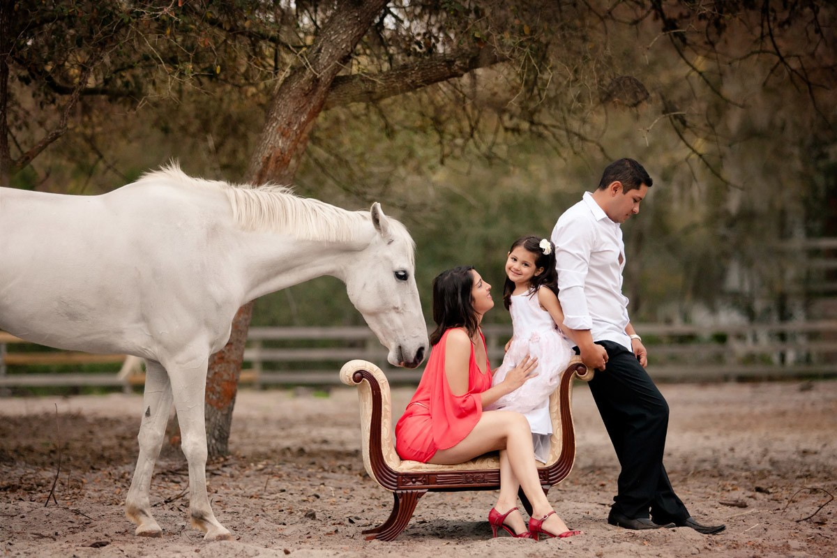 Young family on a farm with white horse by Orlando photographer