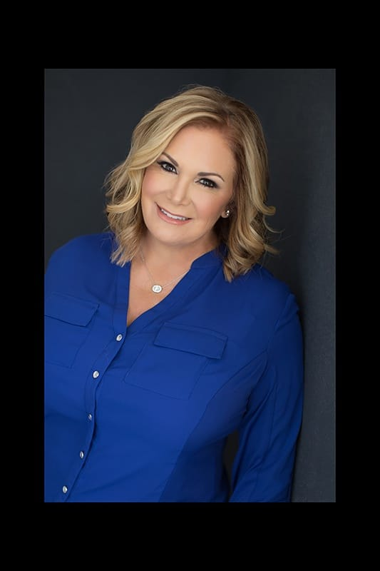 Woman-in-blue-headshot-leaning