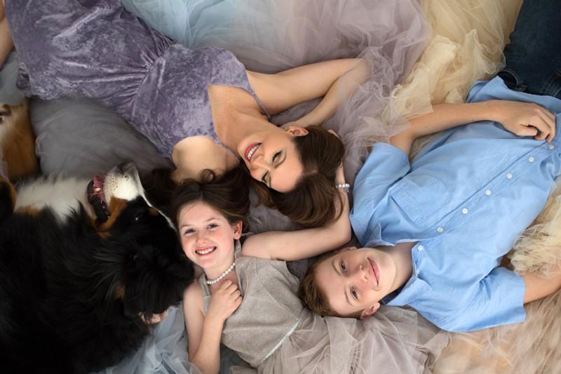 family-lying-on-floor-smiling