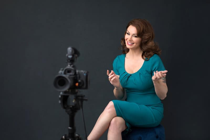 business-woman-is-being-filmed-while-smiling