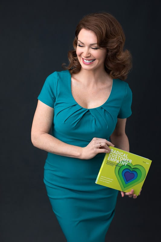 business-woman-smiling-and-holding-her-book