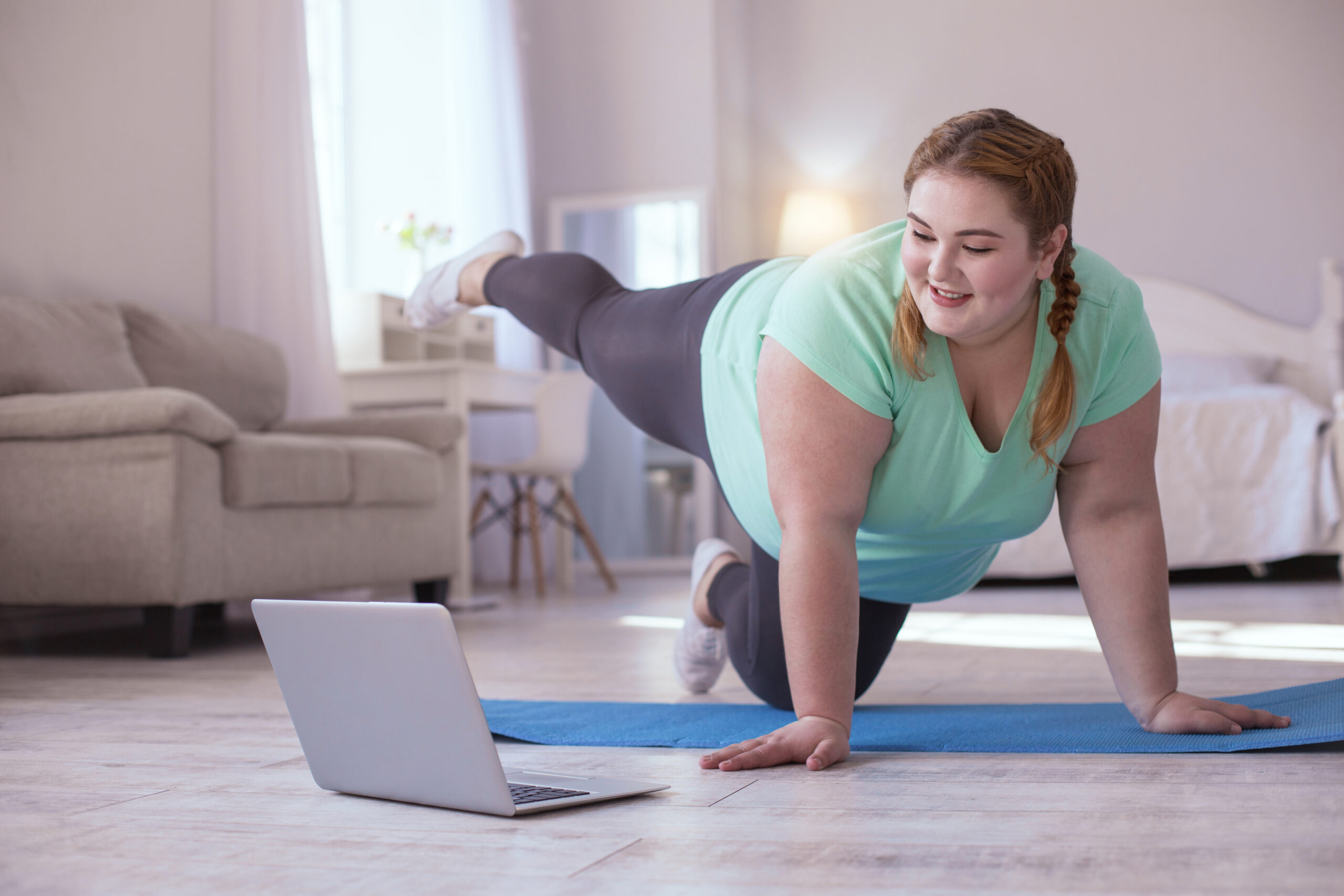 Woman working out with virtual trainer