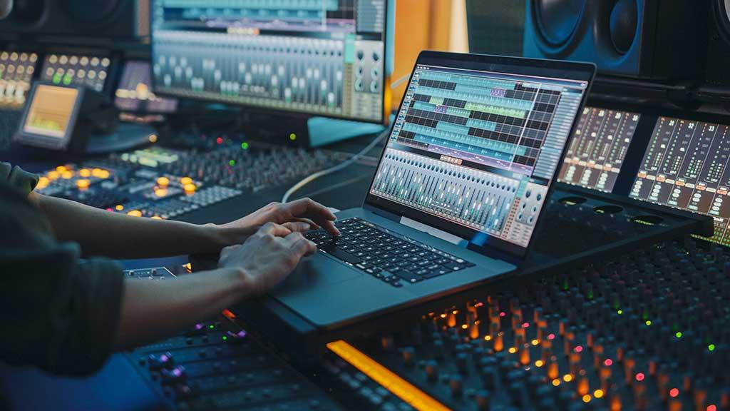 Modern Music Record Studio Control Desk with Laptop
