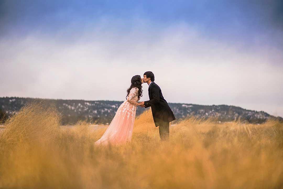 Alan & Heidi couple kissing mountains