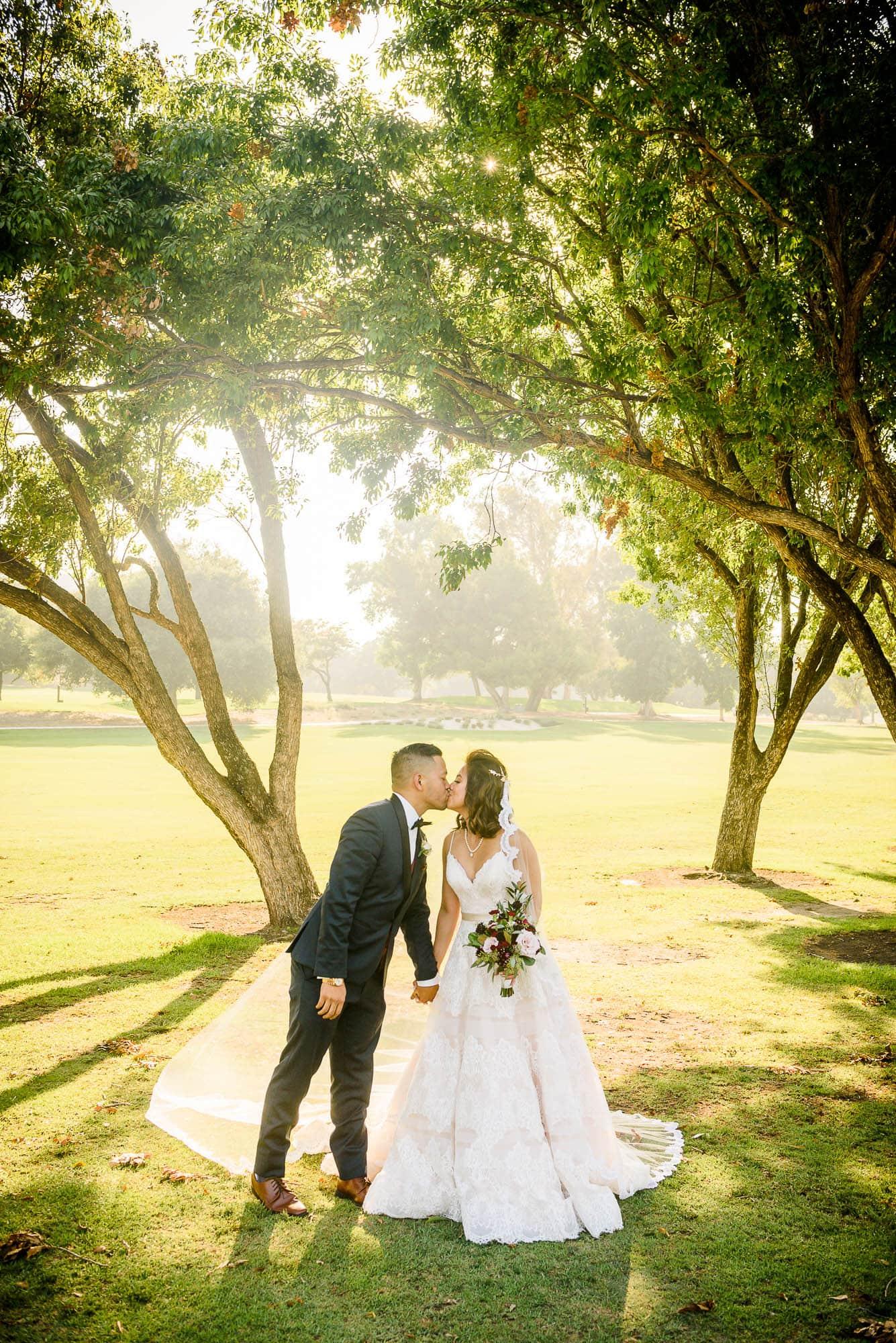 Alan & Heidi Bride Groom Field Kissing