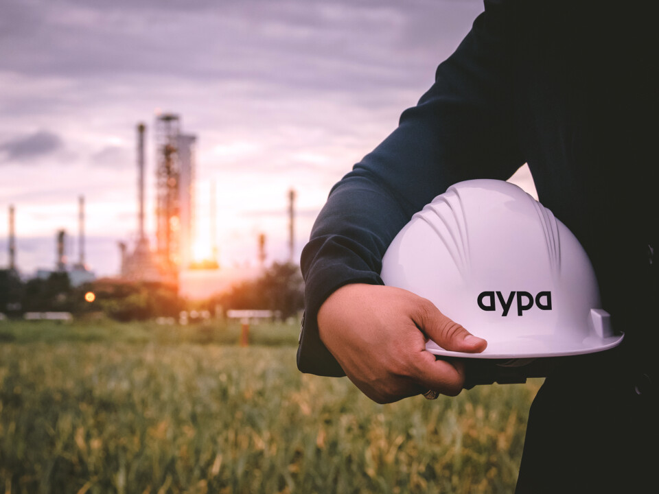 The Aypa logo displayed on a hard hat.