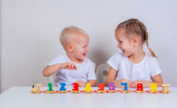 Children,Play,A,Toy,Wooden,Train,With,Numbers,At,The