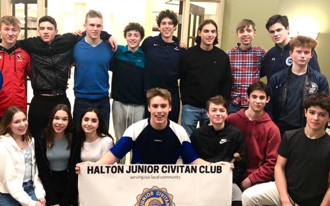 Junior Civitan members holding up their club banner.