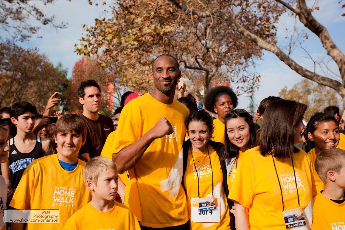 Kobe at HomeWalk surrounded by volunteers