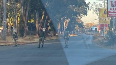 Photo of Soldiers stamp authority as they turn people away from entering the CBD