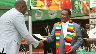 Photo of ED commends young farmers for their efforts.