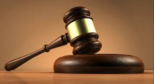 Photo of Maid in court for perfoming indecent acts with a four year old.