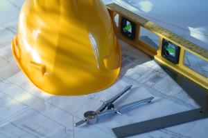 Hard hat, level, construction plans