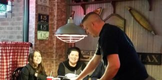 Chris Sackrider serving pizza at Big Dog's Pizza West Chester, Ohio Butler County.